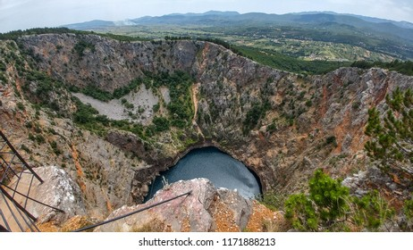 Red Lake (Croatian: Crveno jezero) is a collapse doline (collapse sinkhole) containing a karst lake close to Imotski, Croatia. It is 530 metres deep, thus it is the largest collapse doline in Europe.