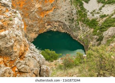 Red Lake is a sinkhole containing a karst lake near the city of Imotski, Croatia.