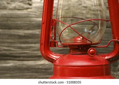 Red Lantern Against Wooden Wall