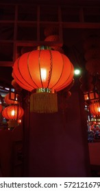 Red Lantern Hang on Ceiling with few at the background