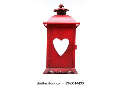 Red lantern with heart shaped window isolated on a white background. It can be a symbol for prostitution.