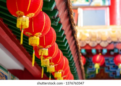 red lanterns of buddha temple, horisontal shot, selective focus