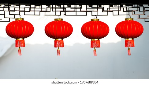 Red lanterns of Chinese traditional festivals under ancient buildings
