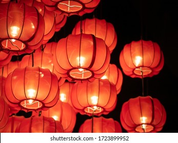 Red lanterns in the darkness, Japanese or Chinese lanterns. Close up and Selective focus