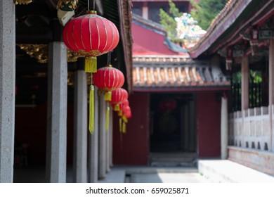 Red lanterns hanging at a corridor inside Kaiyuan temple at Chaozhou town, Guangdong, China.