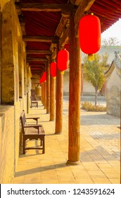 Red lanterns hung under a long wooden porch in Pingyao, China
