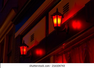 Red lanterns on the wall in Red Light District in Amsterdam, Netherlands