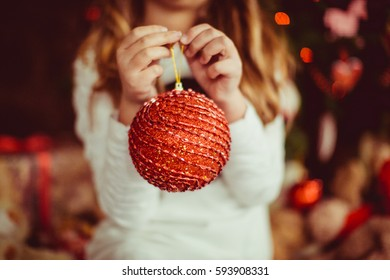 red large ball for christmas tree held by little girl - Large Christmas Balls