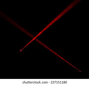 Red laser beams on black background