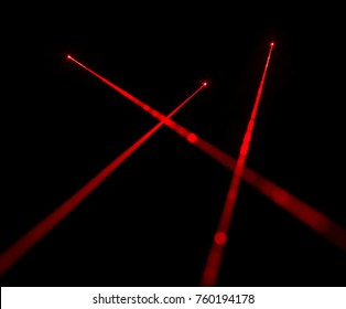 Red laser beams on black background