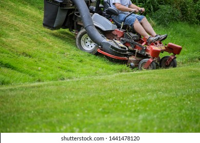 Red Lawn mower cutting gardening grass process of lawn mowing