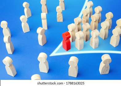 Red leader with followers in arrow formation direction breaks through the crowd. Breaking new ground. Society consolidation. Reform movement, political force. Commitment to change. Public response.