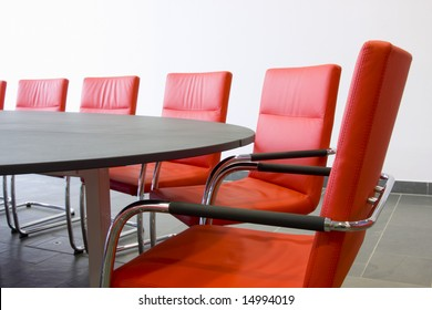 Red leather armchairs in a meeting room
