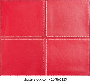 Red leather background from four parts