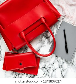 red leather bag and accessories - flat lay