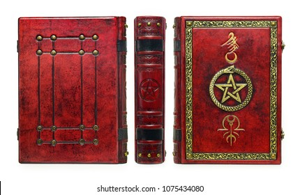 Red leather book with gilded frame, pentagram and metal clasps. Isolated book staying to the table, the front and the back cover plates captured frontal.
