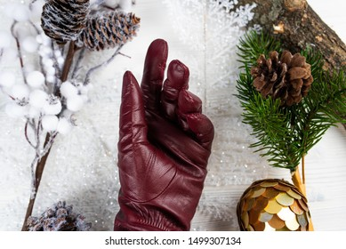 red leather gloves on christmas white wooden background