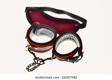 Red leather handcuffs and mask for eyes