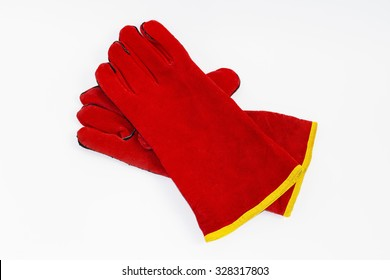 Red leather heat-resistant  Safety Gloves for welders. Gloves for welding. Chaps, heat-resistant fire. Gloves leggings resistant, welding and heavy mechanical work. Isolated on white background.
