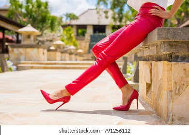 Red leather pants and high heel shoes