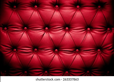 Red leather texture background with buttoned pattern