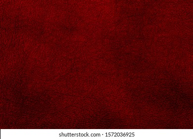 Red leather texture background, faux leather pattern. Top view.