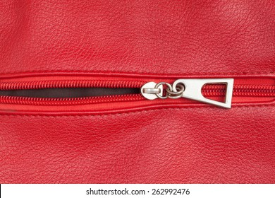 red leather texture with open zipper