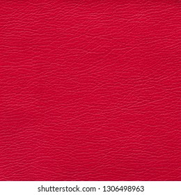 Red leather textured background. Vintage fashion background for designers and composing collages. Luxury textured genuine leather of high quality.