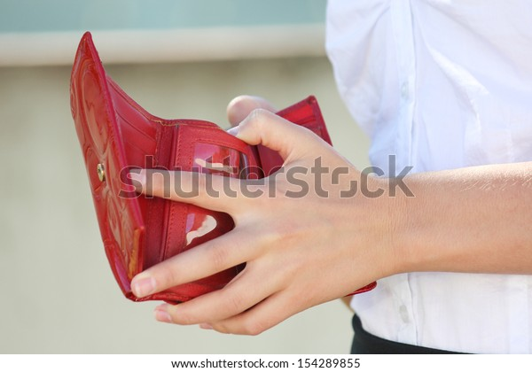 red leather wallet in young female hands