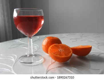 Red lemonade with oranges on the table