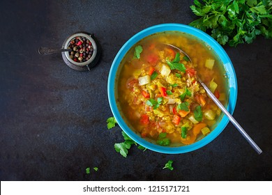 Red lentil soup on dark background. Healthy eating concept. Vegan food. Top view. Flat lay