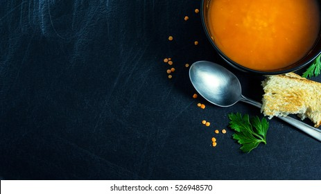 Red lentil soup and parsley with copy space