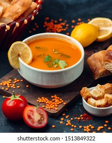 Red lentil soup with a slice of lemon and breadcrumbs