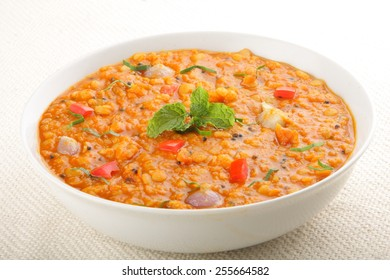 Red lentil soup with tomato and fresh herbs,Asian cuisine.with selective focus.