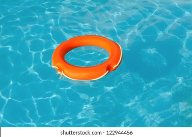 Red Life Buoy floating in swimming pool
