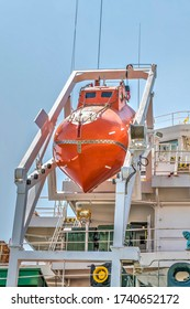 Red Lifeboat hanging on vessel.Stock Image.
