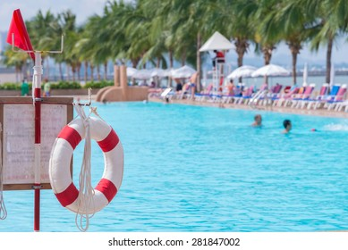 red lifebuoy near public swimming pool.