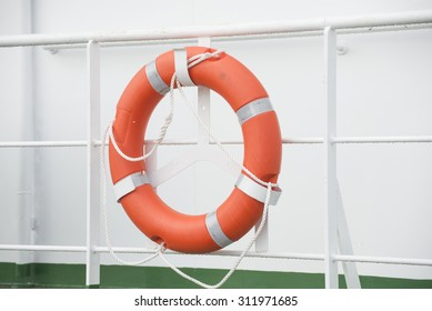 The red lifebuoy on white background of boat