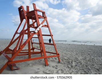 Red lifeguard chair facing the water at Jacksonville Beach in Jacksonville Beach, Florida, USA on a sunny day.