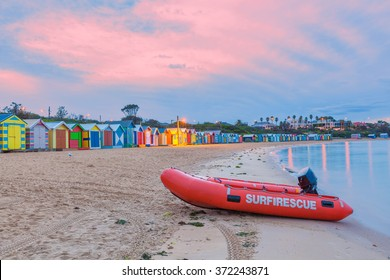 Red lifeguard rescue boat on a beach with colorful bathing huts, Melbourne, Australia
