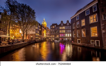 Red light district in Amsterdam during night times with the canals and grachten