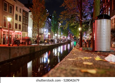 Red Light District at night. It is probably the world's most famous in its kind. There are over 500 windows in the Amsterdam Red Light District and about 1000 working girls.