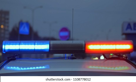 Red light flasher atop of a police car.