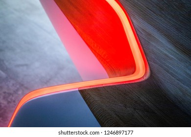 Red light under curved wooden surface