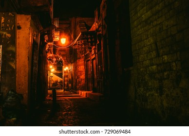 Red Lighted alleyway in old Muizz Street in Cairo, Egypt