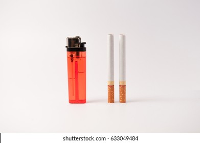 Red lighter and cigarette stand on a white background