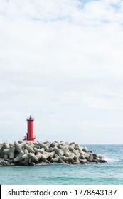 Red lighthouse above the breakwater - Shutterstock ID 1778643137