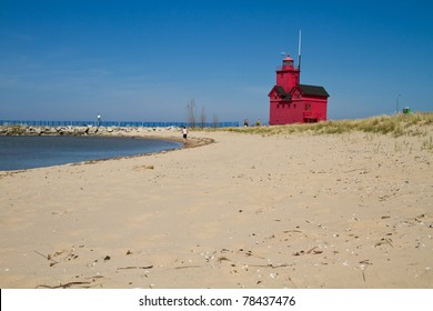 Red lighthouse along the beach of Lake Michigan