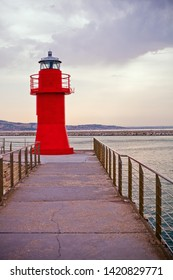 Red lighthouse of Ancona, Italy, on a sunny evening in summer, sunset.