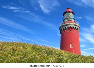 Red lighthouse in beach-grass, Bovbjerg Light house. The Danish West Coast. Denmark